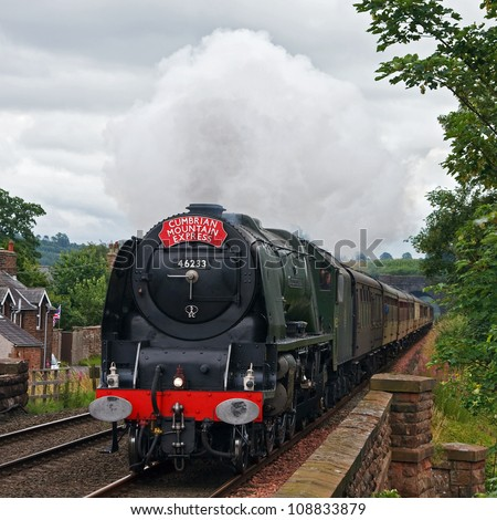 LAZONBY, ENGLAND - JULY 28: Preserved steam locomotive 46233, Duchess of Sutherland, heads the Cumbrian Mountain Express into Lazonby station on July 28, 2012, on the Settle to Carlisle railway. - stock photo