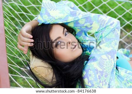 lazy brunette - stock photo