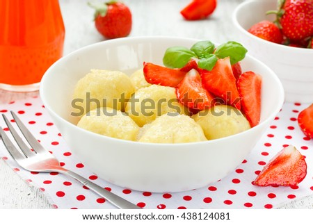 Lazy cheese dumplings with fresh strawberry selective focus - stock photo