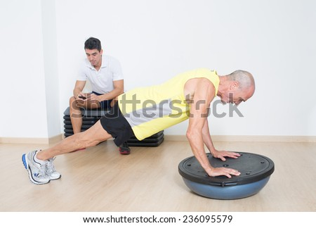 Lazy personal trainer - stock photo