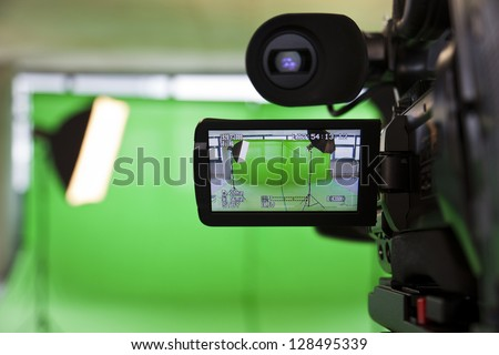 LCD display screen on a High Definition TV camera in a green screen studio. - stock photo