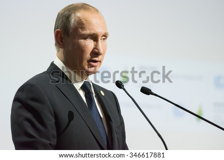 LE BOURGET near PARIS, FRANCE - NOVEMBER 30, 2015 : President of Russia Vladimir Putin delivering his National statement at the Paris COP21, United nations conference on climate change. - stock photo