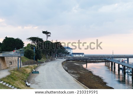 LE CROISIC, FRANCE - JULY 26, 2014: sunset over urban port in Le Croisic town, France. Le Croisic is town in Loire-Atlantique department in western France on Atlantic coast