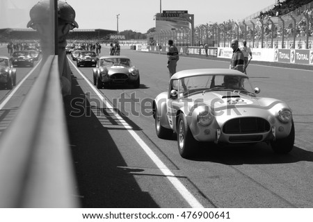 LE MANS, FRANCE, July 10, 2016 : Traditional Le Mans start during Le Mans Classic on the circuit of the 24 hours. No other event in the world assembles so many old racing cars in the same place.