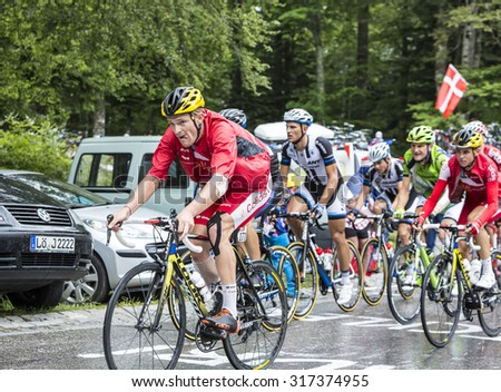 LE MARKSTEIN, FRANCE - JUL 13:The cyclist Adrien Petit of Team Cofidis, climbing the road to mountain pass Le Markstein in Vosges mountains during the stage 9 of Le Tour de France on July 13, 2014. - stock photo
