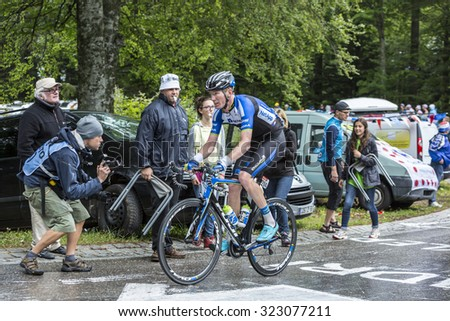LE MARKSTEIN, FRANCE - JUL 13: Zakkari Dempster of NetApp-Endura team climbing the road to mountain pass Le Markstein in Vosges Mountains during the stage 9 of Le Tour de France on July 13, 2014 - stock photo