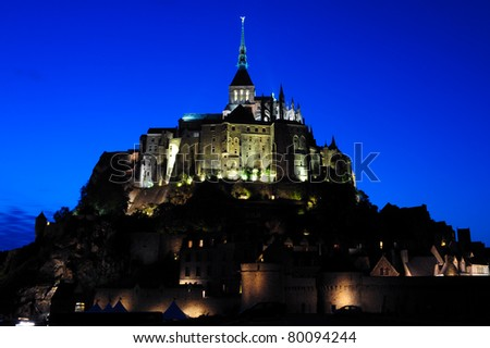 Le Mont Saint Michel Abbey in Normandie, France. Night photo. - stock photo