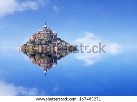 Le Mont Saint Michel, an UNESCO world heritage site in France, with reflection - stock photo
