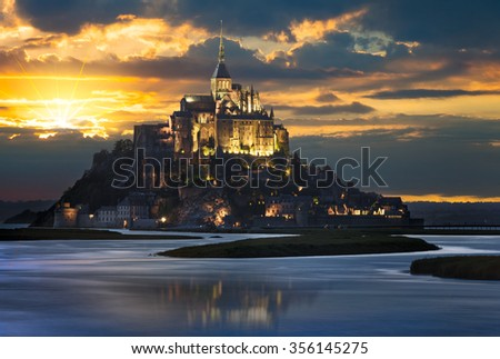Le Mont-Saint-Michel at sunset, Normandie, Bretagne, France, Europe - stock photo