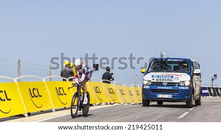 LE MONT SAINT MICHEL,FRANCE-JUL 10:The German cyclist Marcel Sieberg from Lotto-Belisol Team cycling during the stage 11 of Le Tour de France 2013, a time trial between Avranches and Mont Saint Michel - stock photo