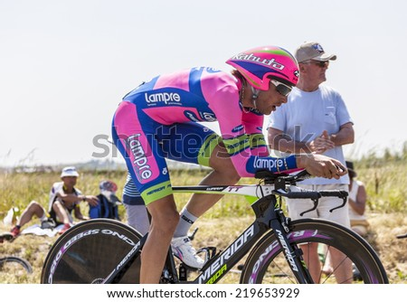 Le Mont Saint Michel,France-July 10, 2013:The cyclist Davide Cimolai from Team Lampre-Merida cycling during the stage 11 of Le Tour de France 2013, a time trial between Avranches and Mont Saint Michel - stock photo