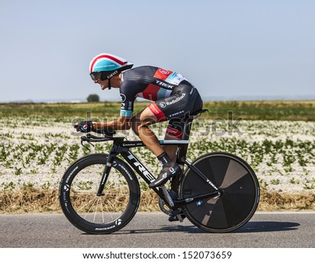 LE PONT LANDAIS,FRANCE-JUL 10:The cyclist Andy Schleck cycling during the stage 11(time trial Avranches -Mont Saint Michel) of the edition 100 of Le Tour de France on July 10, 2013 - stock photo
