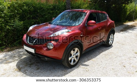 LE VAL - AUG 2 : Nissan Juke, red Crossover in a Park, south of France on August 2, 2015 in Le Val, France - stock photo