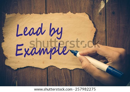 Lead by example - stock photo