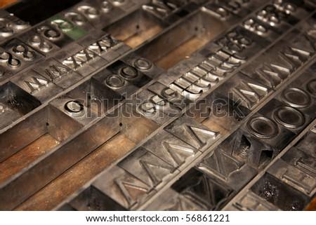 Lead letterpress alphabet arranged in a drawer - stock photo
