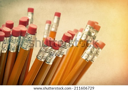 Lead pencils against a vintage paper background - stock photo