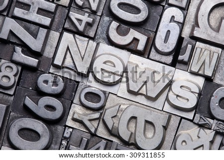 lead type letters form the word news