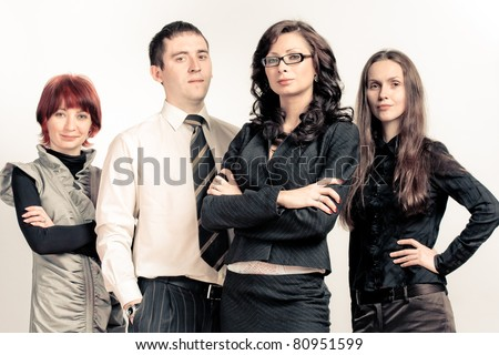 Leader and her team, Young attractive business people with focus only on businesswoman - stock photo