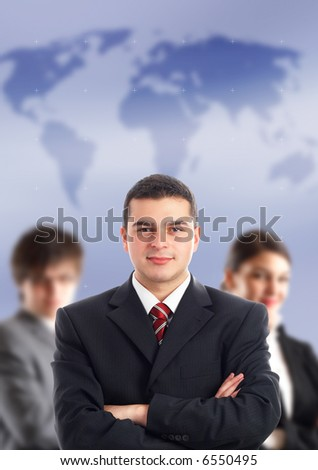 Leader and his team - Young attractive business people with world map in background - focus only on businessman in the middle - stock photo