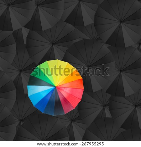Leader holding red umbrella for show different think  - stock photo