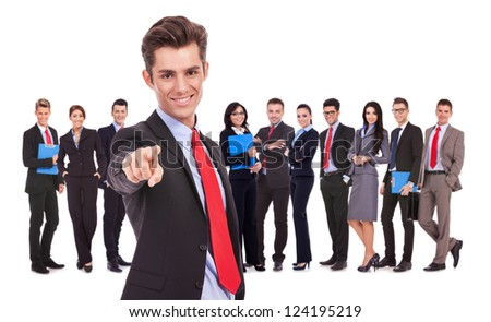leader of a successful business team is choosing you to join them by pointing his finger - stock photo
