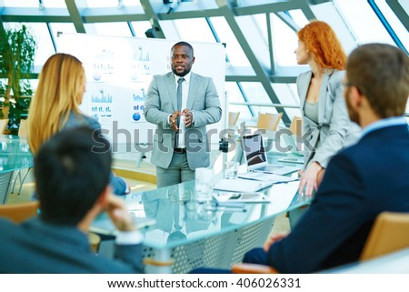Leader of corporation presenting business plans - stock photo