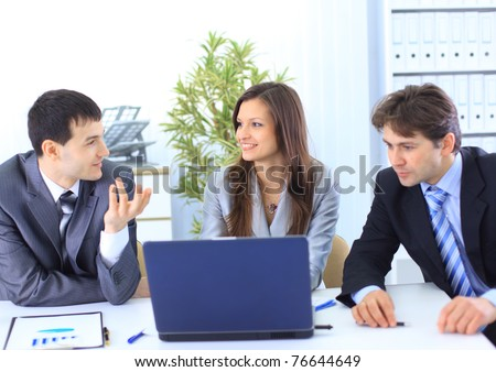 Leader with his successful team discussing in conference room - stock photo
