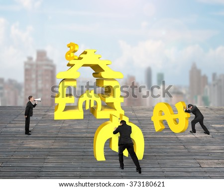 Leader yelling at team member for stacking gold money building on old wooden floor with city view background and daylight - stock photo