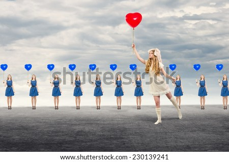 Leadership concept. In a large number of identical girls one looks especially. - stock photo