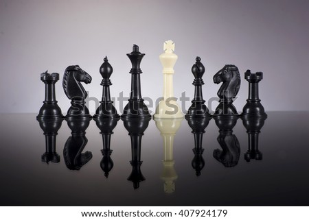 Leadership concept of chess with white king dominate the black chess - stock photo