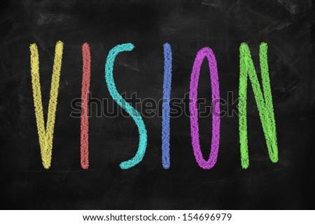Leadership concept vision written on blackboard - stock photo