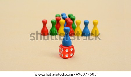 Leadership Concept with colorful pawns and dice