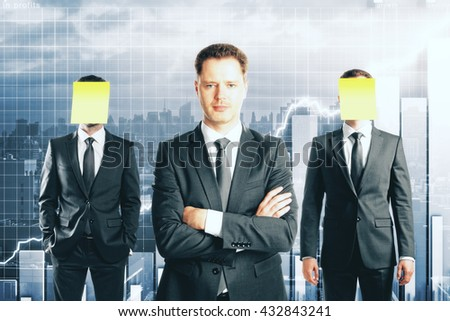 Leadership concept with handsome caucasian businessman in front of businesspeople with covered faces on business chart background - stock photo