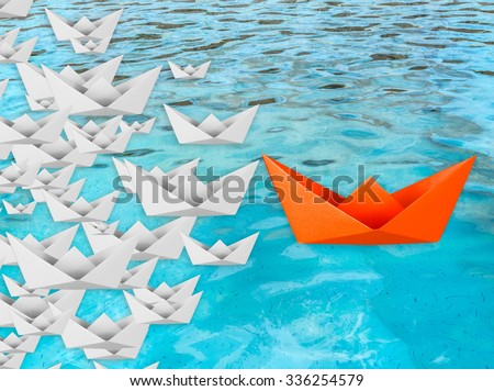 leadership concept with paper boat floating  - stock photo