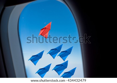 leadership concept with paper plane .View from Window airplane  - stock photo