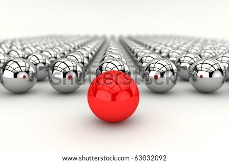 Leadership concept with red sphere and many chrome spheres and depth of focus effect - stock photo