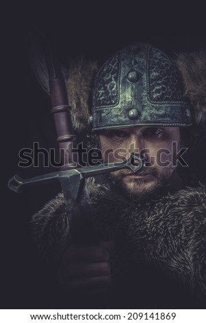 Leadership, Costume, Viking warrior with a huge sword and helmet with horns