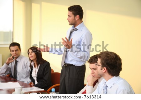 Leadership - Male Boss Speech At The Meeting - stock photo
