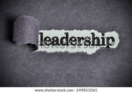 leadership word under torn black sugar paper  - stock photo