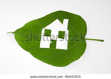 Leaf cut house. Real estate. Ecology usage - stock photo