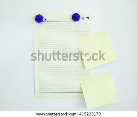 Leaf from the daily log on a white magnetic board with colored magnets - stock photo