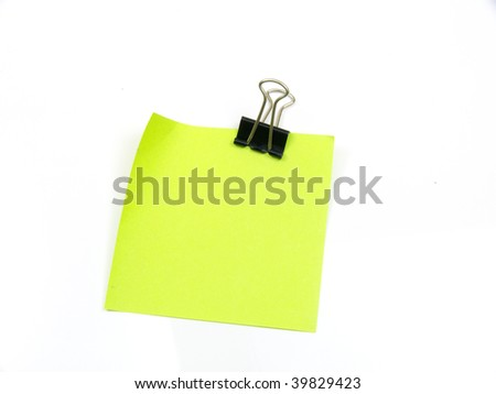 Leaf with a clothespin on a white background - stock photo