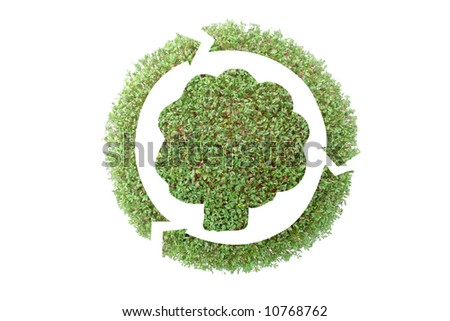 Leafy tree silhouette surrounded by three-arrow symbol superimposed on green plant - recycled paper concept - stock photo