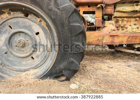 leak tractor wheel, which is old tire, in farm - stock photo