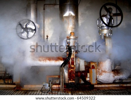 Leakage of steam in a control station in a power plant - stock photo