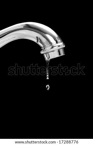 leaking plumbing, wasting potable water - stock photo