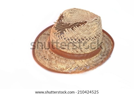 Leaky straw hat isolated on white