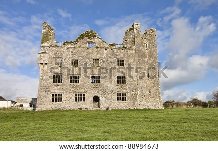 Leamaneh Castle is located in the stark, magnificent setting of The Burren in County Clare, Ireland. - stock photo