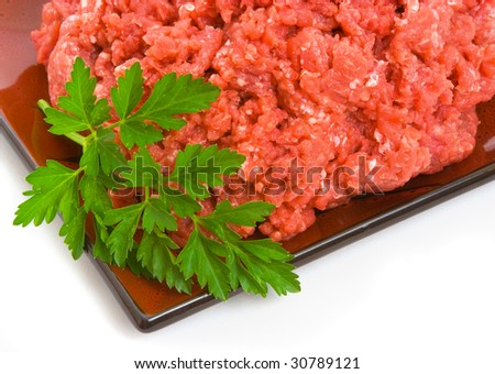 Lean minced steak on plate isolated over white background - stock photo