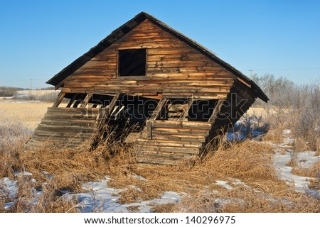 Leaning barn or shed - stock photo